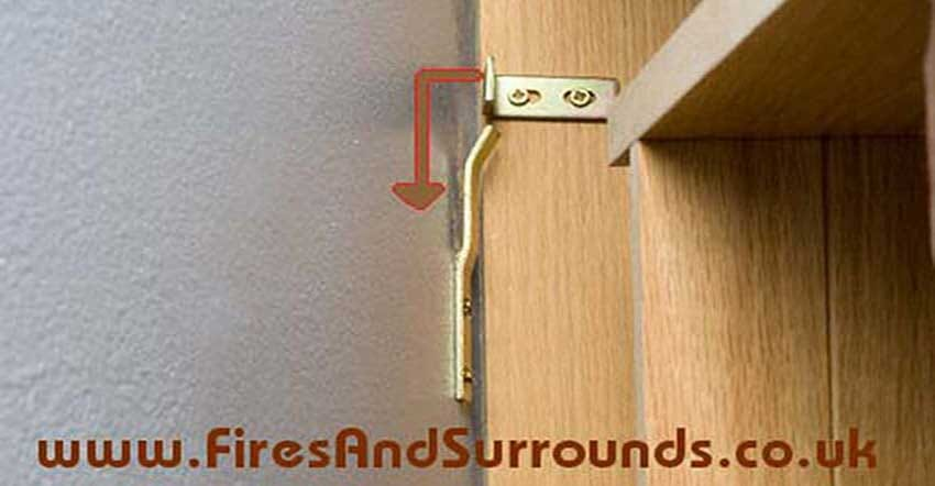 Shows how a hidden fireplace fitting bracket works
